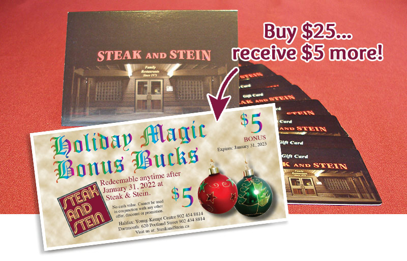 Steak and Stein gift cards stacked up. In front of them is a Magic Bucks card.
